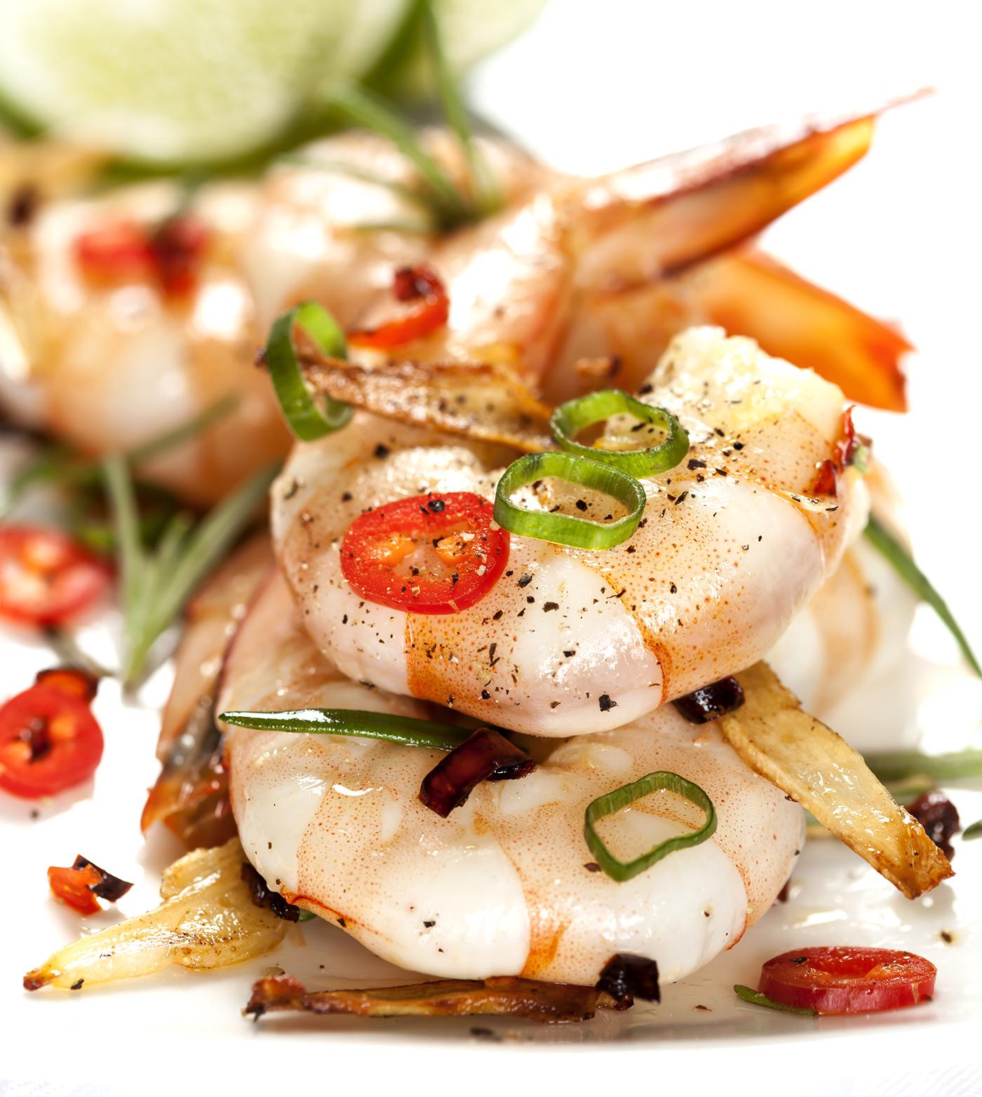 Garlic prawns garnished with red chili.