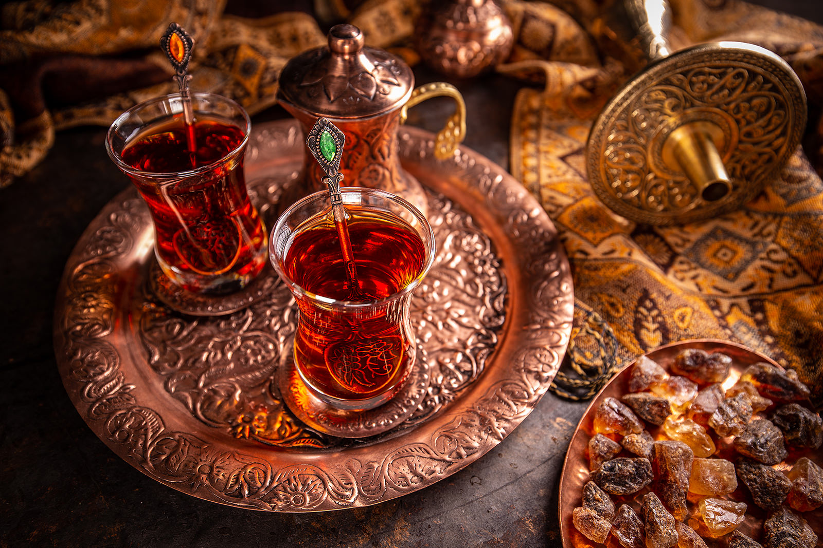 Turkish tea with authentic glass cup and copper tea kettles